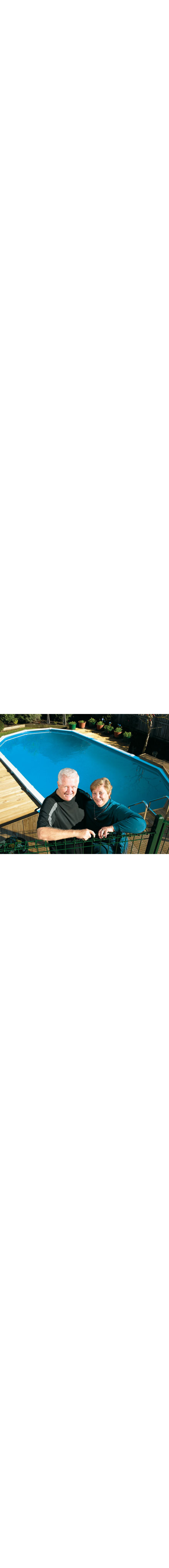 Big-Six Swimming Pool -  installed in-ground with seats showing.