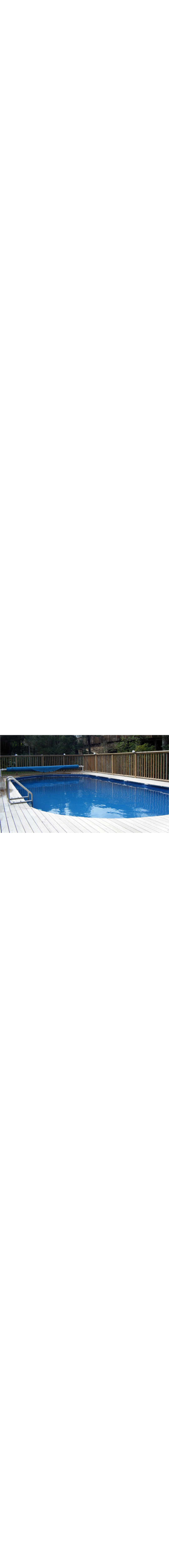 Lido Swimming Pool - installed above-ground and finished with deck surround. Fitted with optional solar heating cover and roller.