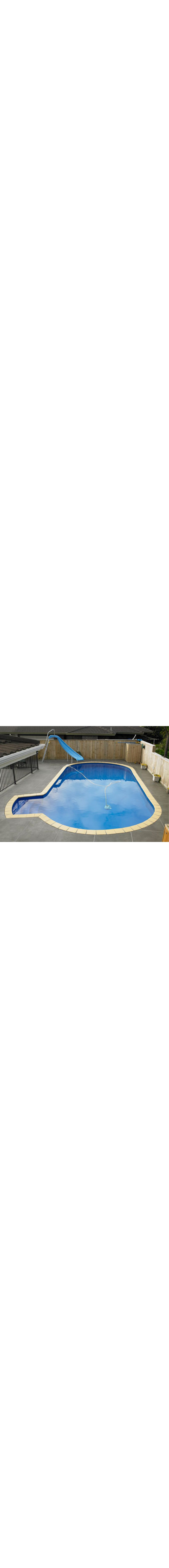 A Lido Swimming Pool - installed in-ground and finished with tiles and walk out stairs (optional extra)